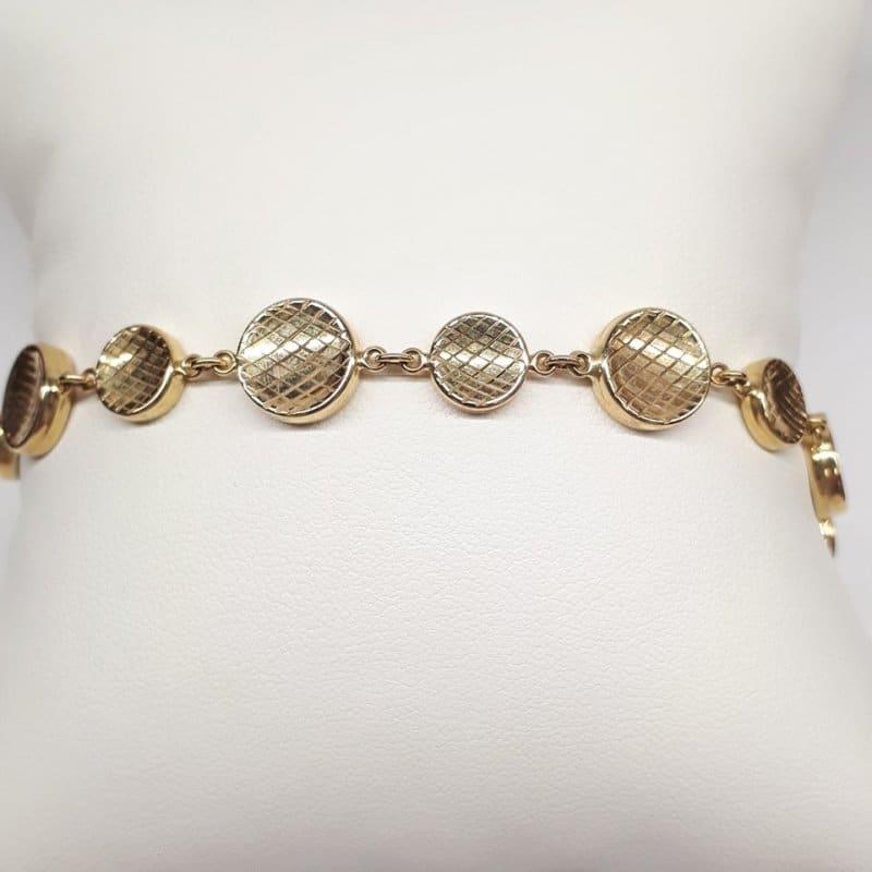 Złota bransoletka pikowane koła